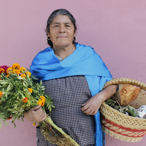 Mexican Woman with Flowers and Bread