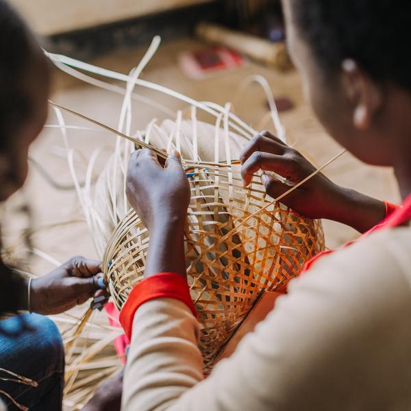 Children weaving baskets in Rwanda