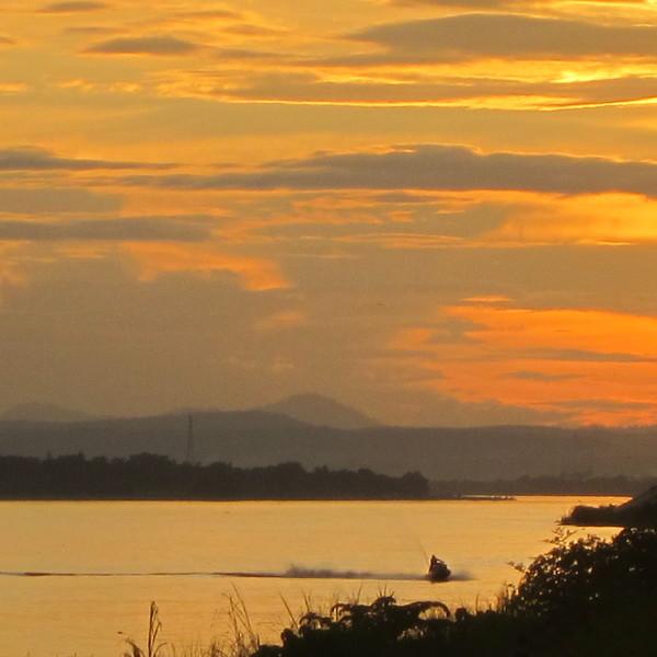 Enjoying an unforgettable sunset along the Mekong River Laos