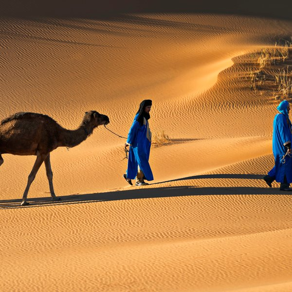 Overnigh in the Sahara desert and camel riding.