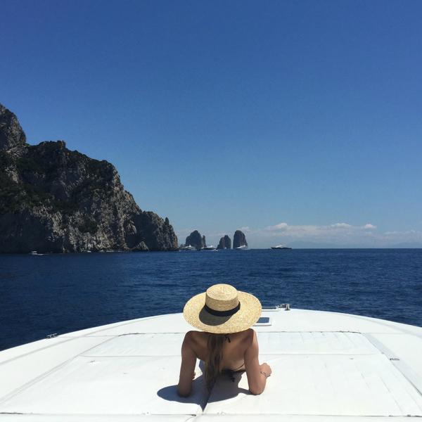 Amalfi coast boat with woman