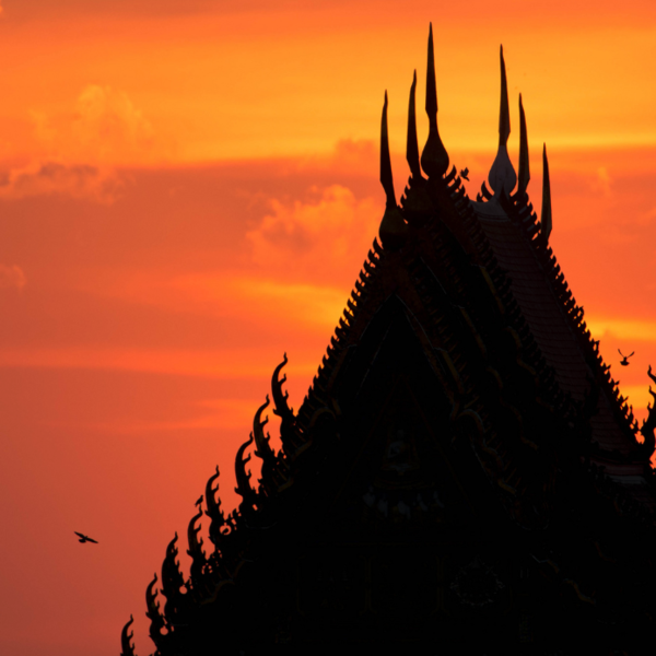 Sunset behind temple roof